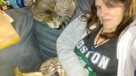 Staying warm with my pets on the couch.